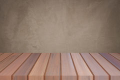Empty top wooden table with concrete wall background. For product display royalty free stock photos