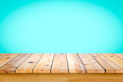 Empty top of wooden table or counter on cyan gradient b. Empty wooden table with cyan gradient wall background. For display or montage your products royalty free stock photography
