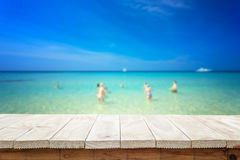 Empty top of wooden table or counter and view of tropical beach Royalty Free Stock Image