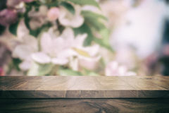 Empty top wooden table. And floral blurred background Stock Photography