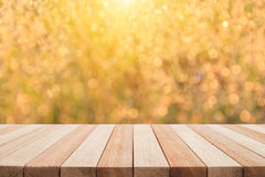 Empty top wooden table and sunny abstract blurred bokeh backgrou Stock Photography