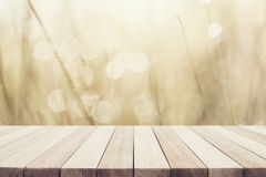 Empty top wooden table and sunny abstract blurred bokeh backgrou Royalty Free Stock Photos