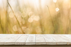Empty top wooden table and sunny abstract blurred bokeh backgrou Stock Photos
