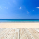 Empty top of wooden table and view of tropical beach. Background. For product display Stock Photos