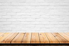 Empty top of wooden table on white brick background. For display or montage your products stock images