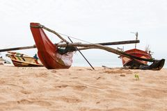 Empty traditional red Sri Lankan fishing boats royalty free stock images