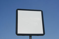 Empty traffic sign. A close-up of a blank traffic sign. The picture has a clear blue sky at the background. Ideal for lots of designs and projects Stock Photography
