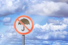 Empty traffic sign on a blue sky background with a picture of a crossed umbrella concept of a good mood stock image