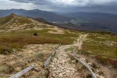 Empty trail in the mountains of central europe. A path leading high in the mountains. Spring time stock photos