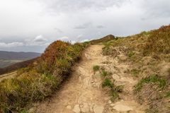 Empty trail in the mountains of central europe. A path leading high in the mountains. Spring time royalty free stock images