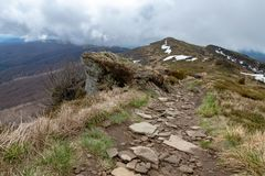 Empty trail in the mountains of central europe. A path leading high in the mountains. Spring time stock photo