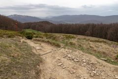 Empty trail in the mountains of central europe. A path leading high in the mountains. Spring time stock photography