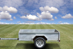 Empty trailer on green grass Stock Image