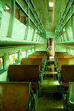 Old train carriage interior. Interior of an old two-level train carriage with wooden seats Stock Photo