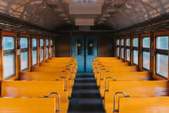 Empty train car without passengers. Empty train wagon with yellow seat seats without passengers, Russian commuter train Stock Photo