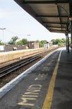 Empty train station platform - mind the gap warning Stock Photography