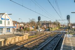 Empty train station in small dutch village during wintertime. Twelllo, the Netherlands, December 17th 2017: Empty train station in small dutch village during Stock Images