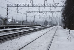 Empty train station. Winter. Empty train station in the forest. Winter. Snowing Stock Photography