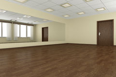 Empty training dance-hall with yellow walls and dark wooden floo Royalty Free Stock Photography