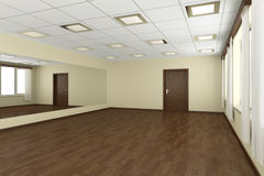 Empty training dance-hall with yellow walls and dark wooden floo Stock Photography