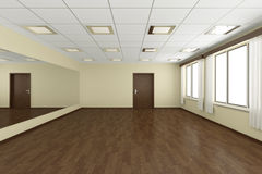 Empty training dance-hall with yellow walls and dark wooden floo Royalty Free Stock Images