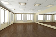 Empty training dance-hall with yellow walls and dark wooden floo Stock Photo