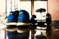 Empty training shoes and dumbbell Royalty Free Stock Image