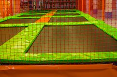 Empty trampolines in children zone stock photo