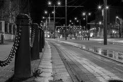 Empty tramway lane by night Royalty Free Stock Photo