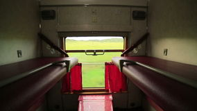 Empty trans siberian train compartment. Empty sleeping class trans siberian train compartment, passing from mongolian vast grassland stock video