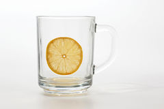 Empty transparent cup of tea with lemon Stock Photo