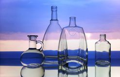 Empty transparent glass bottles forms stock images