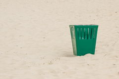 Empty trash can at the beach, littering of environmental, copy space for text Stock Image