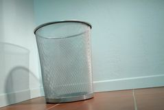 Empty Trash Can in the corner Royalty Free Stock Image