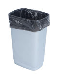 Empty trash container with black plastic bag on white background Stock Image