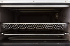 Empty tray inside oven front view Stock Photography
