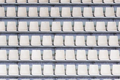 Empty tribune of the soccer stadium. White seats on the tribune of the soccer stadium Stock Photos