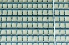 Empty tribune of the soccer stadium. White seats on the tribune of the soccer stadium Royalty Free Stock Images