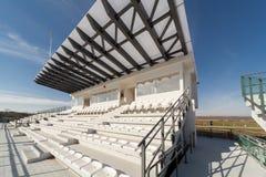 Empty tribunes on a soccer (football) stadium Stock Images