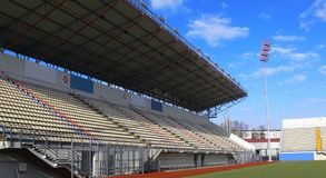Empty tribunes on soccer stadium Royalty Free Stock Photography