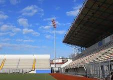 Empty tribunes on soccer stadium 2. Empty tribunes on a soccer stadium under bright sky Royalty Free Stock Photography