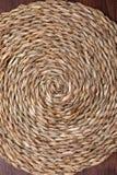 Empty trivet Of natural fibers. On dark wood background. stock photos