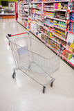 Empty trolley in an aisle Royalty Free Stock Images
