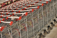 Empty trolley in supermarket Stock Images