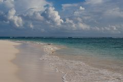 Empty tropical beach. With dramatic sky (Punta Cana, Dominican Republic royalty free stock photo