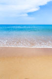 Empty tropical beach and sea with white cloud and blue sky background Stock Photos