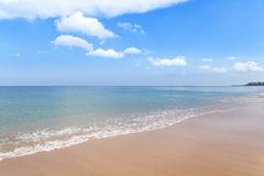 Empty tropical beach and sea with white cloud and blue sky background Royalty Free Stock Photography