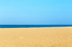 Empty tropical beach and sea with white cloud and blue sky background Royalty Free Stock Image