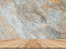 Empty tropical wood table top with dark stone wall,Mock up background for display of product stock photos