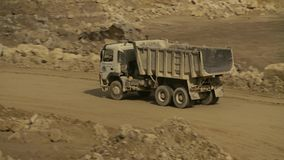 Empty truck on a road in a quarry. Top view of a empty truck on a road in a quarry stock video